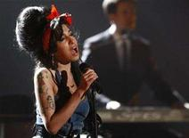 <p>Amy Winehouse performs during the MTV Europe Awards ceremony in Munich November 1, 2007. Winehouse, who entered a rehab clinic last month for drug addiction, will not perform as planned at this year's Grammy awards ceremony after the U.S. embassy in London rejected her visa application. REUTERS/Michael Dalder</p>