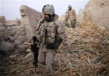 <p>Canadian soldiers from the NATO-led coalition secure positions the day after heavy fighting against insurgents in the Taliban heartland of Sangisar in the Zhari district of Kandahar province, southern Afghanistan, November 18, 2007. REUTERS/Finbarr O'Reilly</p>