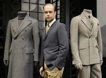 <p>Swedish designer Nilsson poses between two creations of Gianfranco Ferre's Fall/Winter 2008/09 men's collection during Milan Fashion Week. Italian fashion house Gianfranco Ferre has parted ways with Nilsson just five months after hiring him as creative director. REUTERS/Alessandro Garofalo</p>