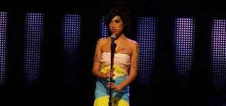 <p>Amy Winehouse performs during the 2007 Mercury Music Awards at the Grosvenor House hotel in London Sepember 4, 2007. REUTERS/Kieran Doherty</p>
