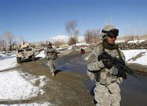 <p>U.S. soldiers patrol the Zormat district of the eastern Paktia province of Afghanistan in this January 26, 2008 file photo. NATO is in disarray and the West faces defeat in Afghanistan unless it overhauls its counter-insurgency and reconstruction strategy, Britain's Paddy Ashdown wrote in an article published on Wednesday. REUTERS/Ahmad Masood/Files</p>