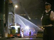 <p>Fire crews douse the Hawley Arms pub in Camden Town, one of the premises damaged by the extensive fires in London February 9, 2008. REUTERS/Luke MacGregor</p>