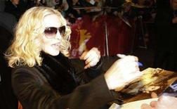 <p>Pop star Madonna signs autographs after a news conference to present her film 'Filth and Wisdom' running at the 58th Berlinale International Film Festival in Berlin, February 13, 2008. The 58th Berlinale, one of the world's most prestigious film festivals, runs from February 7 to 17 in the German capital. REUTERS/Tobias Schwarz</p>
