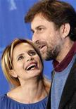 <p>Nanni Moretti and Isabella Ferrari pose pose during a photocall to present their Italian film 'Caos Calmo' (Quiet Chaos) running in the competition at the 58th Berlinale International Film Festival in Berlin, February 13, 2008. REUTERS/Johannes Eisele</p>