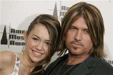 <p>Miley Cyrus and her father Billy Ray Cyrus pose backstage at the 2006 American Music Awards on November 21, 2006 in Los Angeles. Cyrus apologized on Wednesday for being filmed in the back seat of a car with his daughter Miley, who plays Hannah Montana in the hit Disney series, without wearing seat belts. REUTERS/Lucy Nicholson</p>