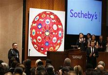 "<p>Singer Bono (L) addresses the crowd at the beginning of Sotheby's ""Red"" auction to raise funds for HIV/AIDS treatment in Africa in New York February 14, 2008. REUTERS/Lucas Jackson</p>"
