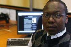 <p>Matuba Mahlatjie, a blogger, is seen in Johannesburg February 13, 2008. Beyond the blogging scene, the Internet's chat rooms and community sites have also become one of the safest ways for gay Africans and Arabs to meet, away from the gaze of a hostile society. REUTERS/Antony Kaminju</p>