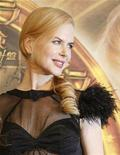 "<p>Nicole Kidman smiles for photographers during a news conference for the film ""The Golden Compass"" in Tokyo February 20, 2008. REUTERS/Yuriko Nakao</p>"