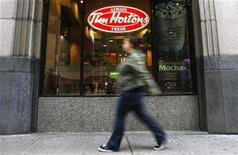 <p>A pedestrian walks past a Tim Hortons restaurant in Toronto, October 26, 2007. Fourth-quarter profit at Tim Hortons Inc rose 11.5 percent, the coffee and doughnut chain said on Wednesday, as growth in same store sales helped to offset higher costs. REUTERS/Mark Blinch</p>