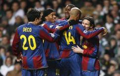 <p>O argentino Lionel Messi (direita) brilhou na quarta-feira e marcou dois gols para o Barcelona, que venceu o Celtic por 3 x 2 fora de casa, na partida de ida das oitavas-de-final da Liga dos Campeões. Foto em Glasgow, Escócia, 20 de fevereiro. Photo by David Moir</p>