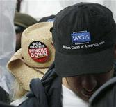 <p>Striking writers wear hats in the rain during at a Writers Guild of America rally at FreeemantleMedia in Burbank, California, December 7, 2007. REUTERS/Fred Prouser</p>