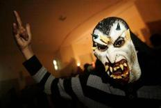 "<p>A supporter dances during the Sidi Rock Festival in Sidi Kacem, near Meknes, February 23, 2008. Hundreds of Moroccan heavy metal fans met on Saturday for their biggest festival in the north African country since a group of hard rock enthusiasts was jailed five years ago for ""Satanism"". REUTERS/Rafael Marchante</p>"