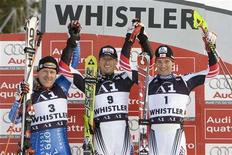 <p>Austria's Hannes Reichelt (C) is flanked by team mate Benjamin Raich (E) and Switzerland's Didier Cuche during Men's World Cup Giant Slalom podium ceremonies in Whistler, British Columbia February 23, 2008. Reichelt was first with Cuche in second and Raich in third. REUTERS/Andy Clark</p>