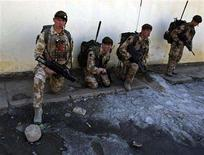 <p>British soldiers take a break after securing an area during medical assistance in Kabul February 26, 2008. REUTERS/Ahmad Masood</p>