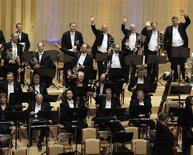 <p>Members of the New York Philharmonic wave to the audience after finishing their concert at the Grand Theatre in the North Korean capital of Pyongyang, February 26, 2008. REUTERS/David Gray</p>
