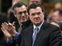 <p>Canada's Finance Minister Jim Flaherty (R) receives a standing ovation from Health Minister Tony Clement while speaking during Question Period in the House of Commons on Parliament Hill in Ottawa, February 14, 2008. REUTERS/Chris Wattie</p>
