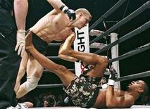 "<p>Andrei Semenov of Russia (L) fights with Jorge Santiago of the U.S. during a BoDog Fight mixed martial arts event in St Petersburg April 14, 2007. CBS is bringing mixed martial arts, the bone-crunching combat sport popularly known as ""cage fighting,"" to prime-time television this spring, the U.S. network said on Thursday. REUTERS/ITAR-TASS/PRESIDENTIAL PRESS SERVICE</p>"