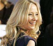 """<p>Anne Heche arrives at The Hollywood Reporter's annual """"Women in Entertainment Power 100"""" breakfast in Beverly Hills December 6, 2005. REUTERS/Mario Anzuoni</p>"""
