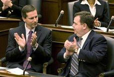 <p>Premier Dalton McGuinty (L) applauds a speech from the throne with Finance Minister Dwight Duncan (R) during the first session of the 39th Parliament of Ontario, November 29, 2007. A slowing U.S. economy, lofty Canadian dollar and record high oil prices will be a drag on Canada's manufacturing heartland of Ontario this year, Duncan said on Monday. REUTERS/Fred Thornhill</p>