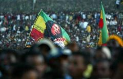<p>An Ethiopian Rastafarian waves a Bob Marley banner among thousands of people who gathered at Meskel Square in the capital Addis Ababa, for a concert marking Bob Marley's 60th birthday, February 6, 2005. Rita Marley is executive producing the first-ever biopic of her late husband Bob Marley, and if she has it her way, the reggae icon's daughter-in-law R&B singer Lauryn Hill will portray her onscreen. REUTERS/Antony Njuguna</p>