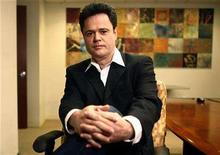 <p>Entertainer Donny Osmond poses for a photograph in New York February 27, 2008. REUTERS/Keith Bedford</p>
