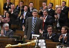 <p>Canada's Prime Minister Stephen Harper (C) receives a standing ovation from his caucus while voting against an amendment to the federal budget in the House of Commons on Parliament Hill in Ottawa March 3, 2008. The Conservatives and the official opposition Liberals have both lost public support and are virtually tied, a poll showed on Tuesday. REUTERS/Chris Wattie</p>