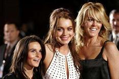 """<p>File photo shows Lindsay Lohan (C) with her mother Dina (R) and her sister Aliana at the premiere of """"Just My Luck"""" at the Mann National theatre in Los Angeles May 9, 2006. Dina Lohan took a lot of heat for managing daughter Lindsay Lohan's rise to stardom and U.S. television viewers now can watch as she shepherds 14-year-old daughter Ali into a show business career in a new reality television show. REUTERS/Mario Anzuoni</p>"""