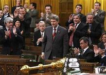 <p>Canada's Prime Minister Stephen Harper (C) receives a standing ovation from his caucus while voting for the federal budget in the House of Commons on Parliament Hill in Ottawa March 4, 2008. REUTERS/Chris Wattie</p>