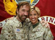 <p>Hollywood action star Chuck Norris (L) poses for a picture with Staff Sergeant Amy Forsythe during his visit to Camp Falluja, 50 km (30 miles) west of Baghdad in this November 2, 2006 file photo. Norris, known for his martial arts prowess and tough-guy image, has become a cult figure among the U.S. military in Iraq and an unlikely hero for some in Iraq's security forces. Picture taken November 2, 2006. REUTERS/Handout/U.S. military/Files</p>