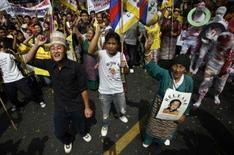 <p>Exilados tibetanos protestam em Nova Délhi. Refugiados tibetanos protestaram no mundo todo na segunda-feira, para marcar o 49o aniversário da revolta contra o comando chinês e pressionar para que a independência corra à dianteira das Olimpíadas de Pequim. Photo by Adnan Abidi</p>