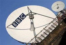 <p>A British Broadcasting Corporation (BBC) satellite dish is seen behind houses in west London, October 18, 2007. The BBC launched an Arabic television service on Tuesday with funding from the government to provide what it said would be independent news, analysis and current affairs. REUTERS/Toby Melville</p>