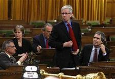 <p>Liberal leader Stephane Dion stands to vote against the federal budget in the House of Commons on Parliament Hill in Ottawa March 4, 2008. REUTERS/Chris Wattie</p>