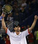 <p>Andy Roddick comemora vitória sobre o espanhol Feliciano Lopez na final do torneio de Dubai, em 8 de março. O tenista número seis do mundo, Andy Roddick, decidiu não participar da Olimpíada deste ano em Pequim para defender seu título do Aberto de Washington. Photo by Steve Crisp</p>