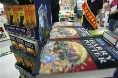 "<p>A saleswoman stands next to Harry Potter books at a bookstore in Beijing August 16, 2007. The final ""Harry Potter"" book, ""Harry Potter and the Deathly Hallows,"" will be adapted into two films, Warner Bros. said Wednesday. REUTERS/David Gray</p>"
