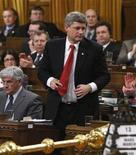 <p>Canada's Prime Minister Stephen Harper stands to vote for a ways and means motion in the House of Commons on Parliament Hill in Ottawa March 13, 2008. REUTERS/Chris Wattie</p>