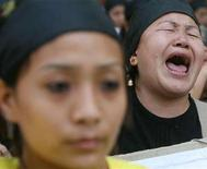 <p>A Tibetan in exile cries as she shouts slogans during a sit-in protest in New Delhi March 15, 2008. Independence protesters burned shops and cars in the Tibetan capital Lhasa on Friday in the fiercest unrest in the region for two decades. Tibetan refugees continued protesting across the world to mark the 49th anniversary of an uprising against Chinese rule and press their demand for independence ahead of the Beijing Olympics. REUTERS/Tanushree Punwan</p>
