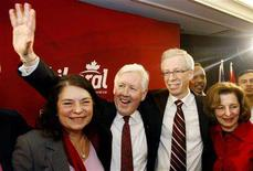 <p>Liberal candidate Bob Rae (2nd L) and his wife Arlene Prely Rae (L) celebrate his by-election victory with Liberal leader Stephane Dion and his wife Janine Krieber (R) in Toronto March 17, 2008. Rae will now have a seat in the House of Commons. REUTERS/Mark Blinch</p>