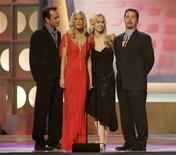 "<p>The cast of the hit television series ""Beverly Hills 90210 (L-R) Luke Perry, Tori Spelling, Jennie Garth and Jason Priestley pay tribute to producer Aaron Spelling, the most prolific producer of television programming in history, prior to presenting Spelling with the Pioneer award at the 3rd annual TV Land Awards in Santa Monica, California March 13, 2005. REUTERS/Fred Prouser FSP</p>"