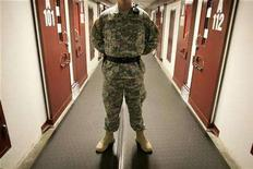 <p>A U.S. Army guard stands in a corridor of cells in Camp Five, a facility at the Guantanamo Bay Naval Station in Guantanamo Bay, Cuba September 4, 2007. REUTERS/Joe Skipper</p>