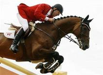 <p>Ian Millar of Canada rides his horse In Style at the final round of the individual equestrian jumping competition at the Pan American Games in Rio de Janeiro, July 29, 2007. REUTERS/Daniel Munoz</p>