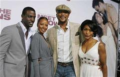 "<p>Model Eva Pigford (2nd L) and cast members Lance Gross (L-R), Tyler Perry and Angela Bassett pose at the premiere of the film ""Tyler Perry's Meet The Browns"" in Hollywood, California March 13, 2008. Perry also wrote, produced and directed the film. REUTERS/Fred Prouser</p>"