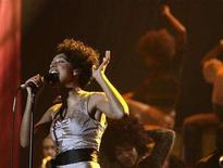 <p>Corinne Bailey Rae performs at the Brit Awards at the Earls Court Arena in London February 14, 2007. The husband of Bailey Rae was found dead and another man was arrested on suspicion of supplying drugs, police said on Sunday. REUTERS/Kieran Doherty</p>