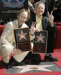 <p>The Doors' guitarist Robby Kreiger (L) and keyboardist Ray Manzarek pose for photographers during the dedication of the 2,329th Star on the Hollywood Walk of Fame in Hollywood February 28, 2007. REUTERS/Gus Ruelas</p>