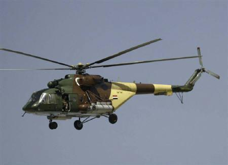 An Iraqi helicopter flies over Basra March 25, 2008. Iraqi security forces battled fighters loyal to Shi'ite cleric Moqtada al-Sadr in Basra on Tuesday in a drive to win control of the southern oil city, triggering a wave of violence in Baghdad and other cities. REUTERS/Atef Hassan