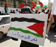 <p>Mulher palestina participa de protesto em Gaza. A facção Fatah, do presidente da Autoridade Palestina, Mahmoud Abbas, disse nesta quarta-feira que desistirá do diálogo com o Hamas caso o grupo islâmico não ceda o controle de Gaza. Photo by Mohammed Salem</p>