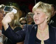 <p>Comedian Ellen Degeneres takes her own picture as she arrives at the 59th Primetime Emmy Awards in Los Angeles, California September 16, 2007. REUTERS/Mario Anzuoni</p>