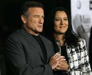 "<p>Robin Williams and Marsha Garces Williams hold hands at the world premiere of ""Man of the Year"" at Grauman's Chinese theatre in Hollywood, California October 4, 2006. REUTERS/Mario Anzuoni</p>"