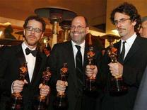 "<p>Directors Ethan Coen (L) and Joel Coen (R) pose at the Governor's Ball after winning Oscars for best director and best adapted screenplay, next to producer Scott Rudin who holds an Oscar for best picture for their work in ""No Country for Old Men"", following the 80th annual Academy Awards, the Oscars, in Hollywood February 24, 2008. REUTERS/Lucy Nicholson</p>"
