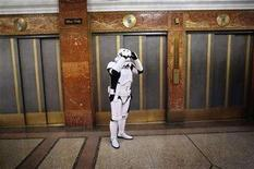 "<p>File photo shows a man dressed as a character from the movie ""Star Wars"" waiting for an elevator in the lobby of the Hotel Pennsylvania in New York November 17, 2007. REUTERS/Jacob Silberberg</p>"