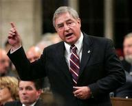 <p>Canada's Trade Minister David Emerson stands to speak at the House of Commons on Parliament Hill in Ottawa September 18, 2006. REUTERS/Chris Wattie</p>
